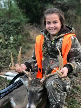 Giana Gilbert with here fist deer at a Georgia Hunting Plantation